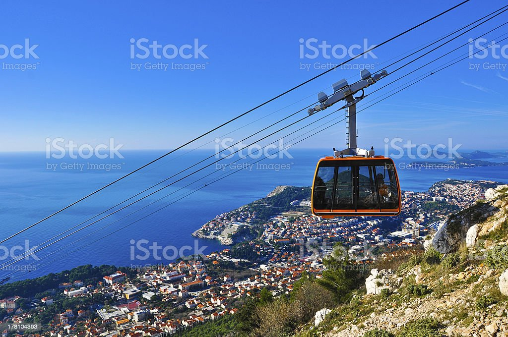A cable car going down a mountain stock photo