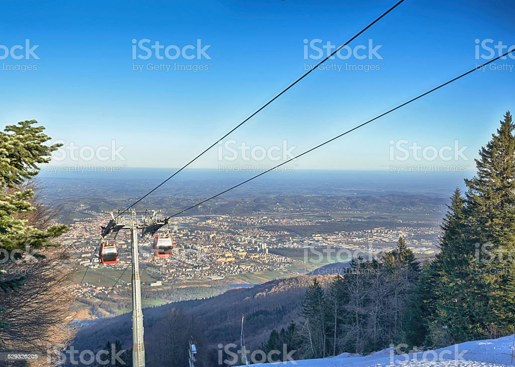 Cable car going to Pohorje over foggy Maribor stock photo