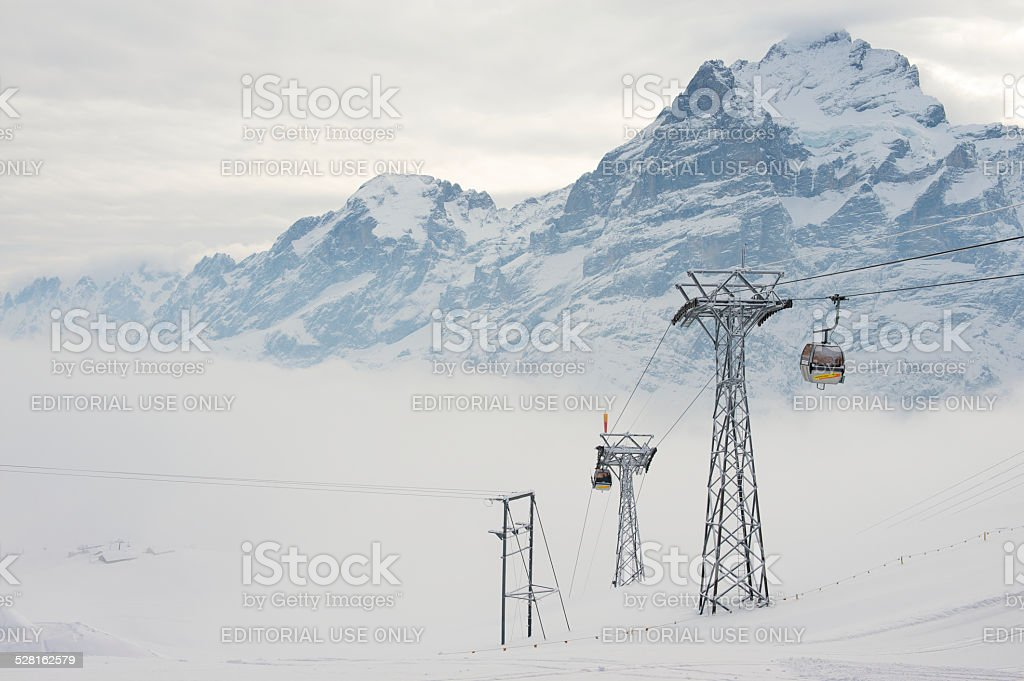 Cable car gondolas move skiers uphill, Grindelwald, Switzerland stock photo