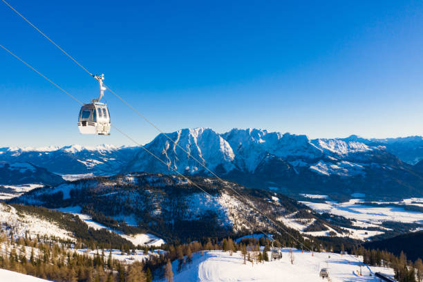 Cable car in a touristic winter skiing resort stock photo