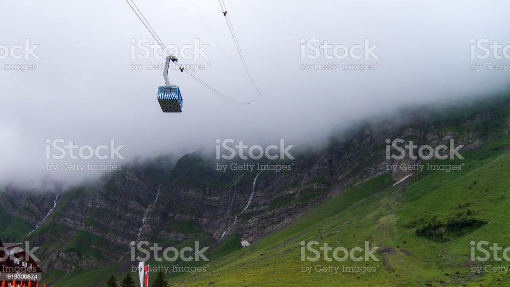 Cable car in the fog stock photo