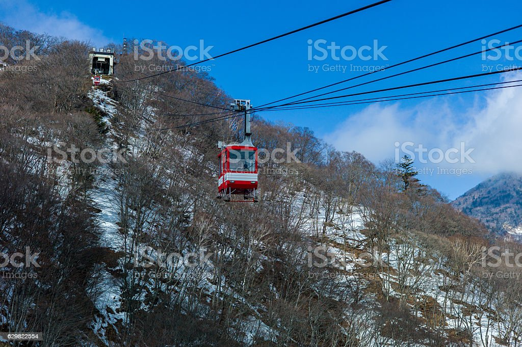 cable car moving up a mountain stock photo
