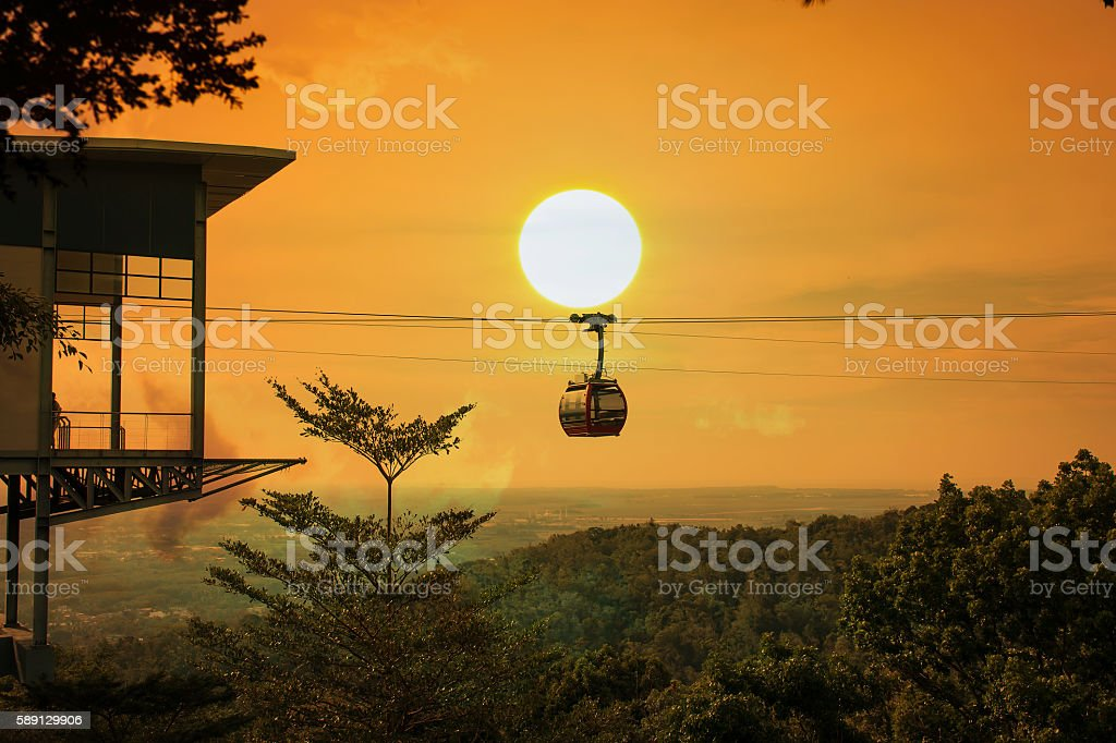 Cable car on the  mountain sunset background stock photo