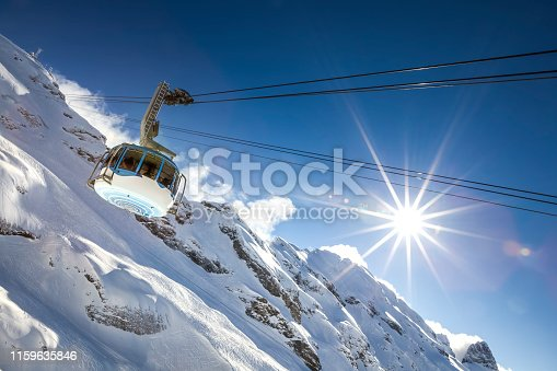 cable car at titlis mountain in the swiss alps in switzerland.