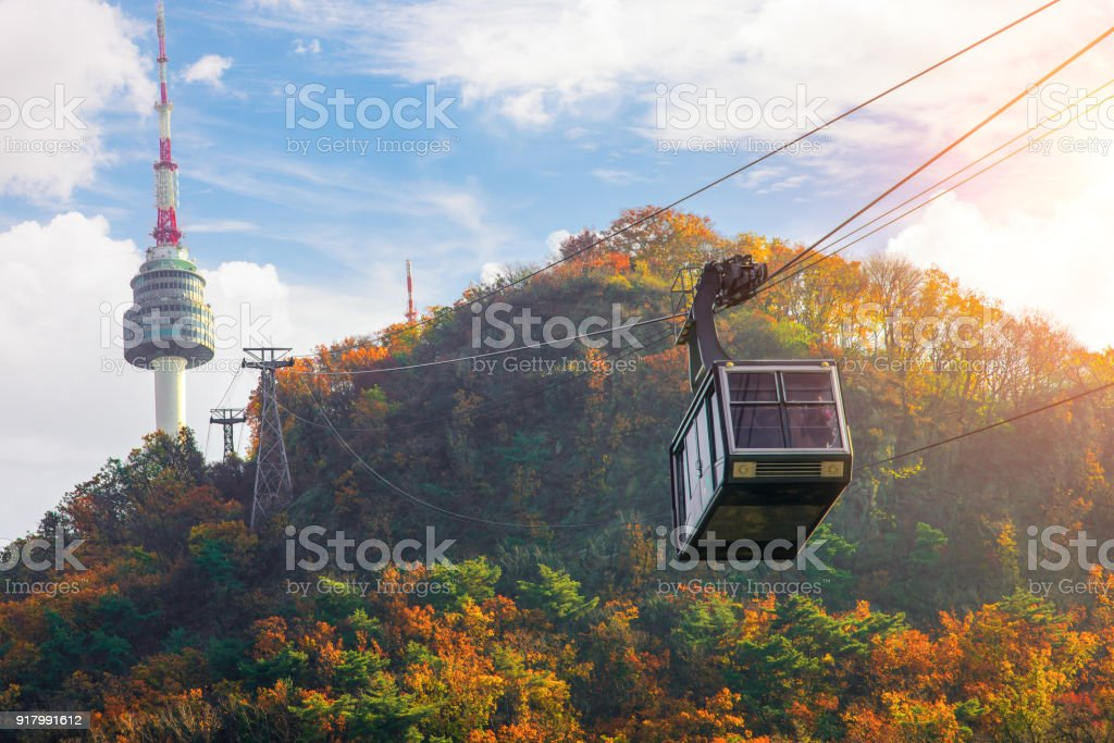 Cable car to Seoul N tower with blue sky and autymn season stock photo