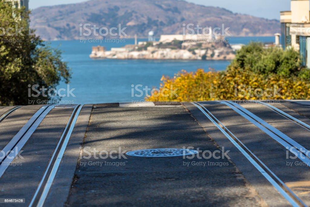 Cable Car tracks and Alcatraz stock photo