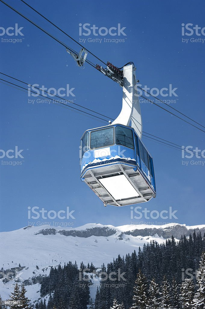 Cable car with specs of snow royalty-free stock photo