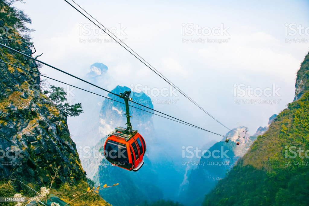 Cable cars in mountain stock photo