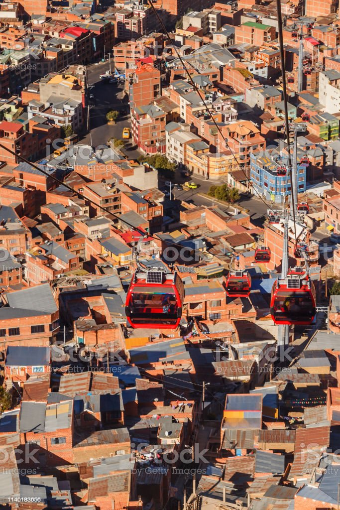 Cable cars or funicular system over orange roofs and buildings of the...