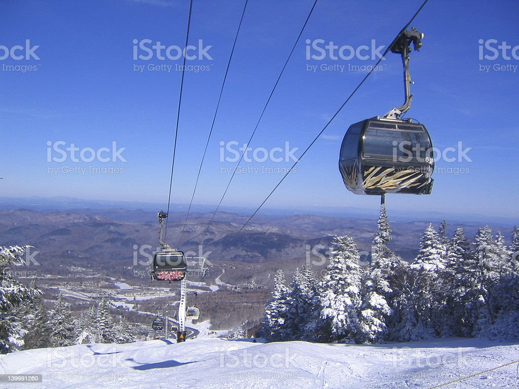 Cable cars over snowy mountain in a ski resort stock photo