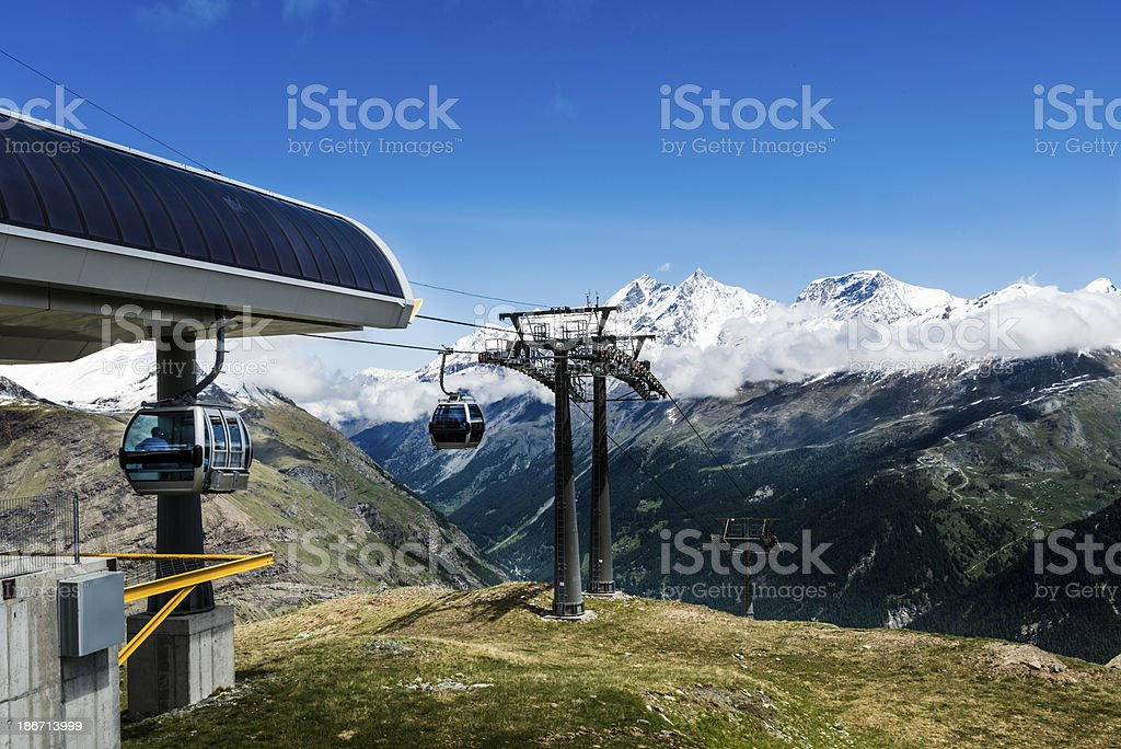 Cable cars with snow capped mountains in the background-XXXL royalty-free stock photo