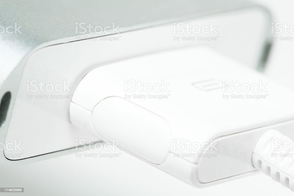 USB cable charging an iPod stock photo