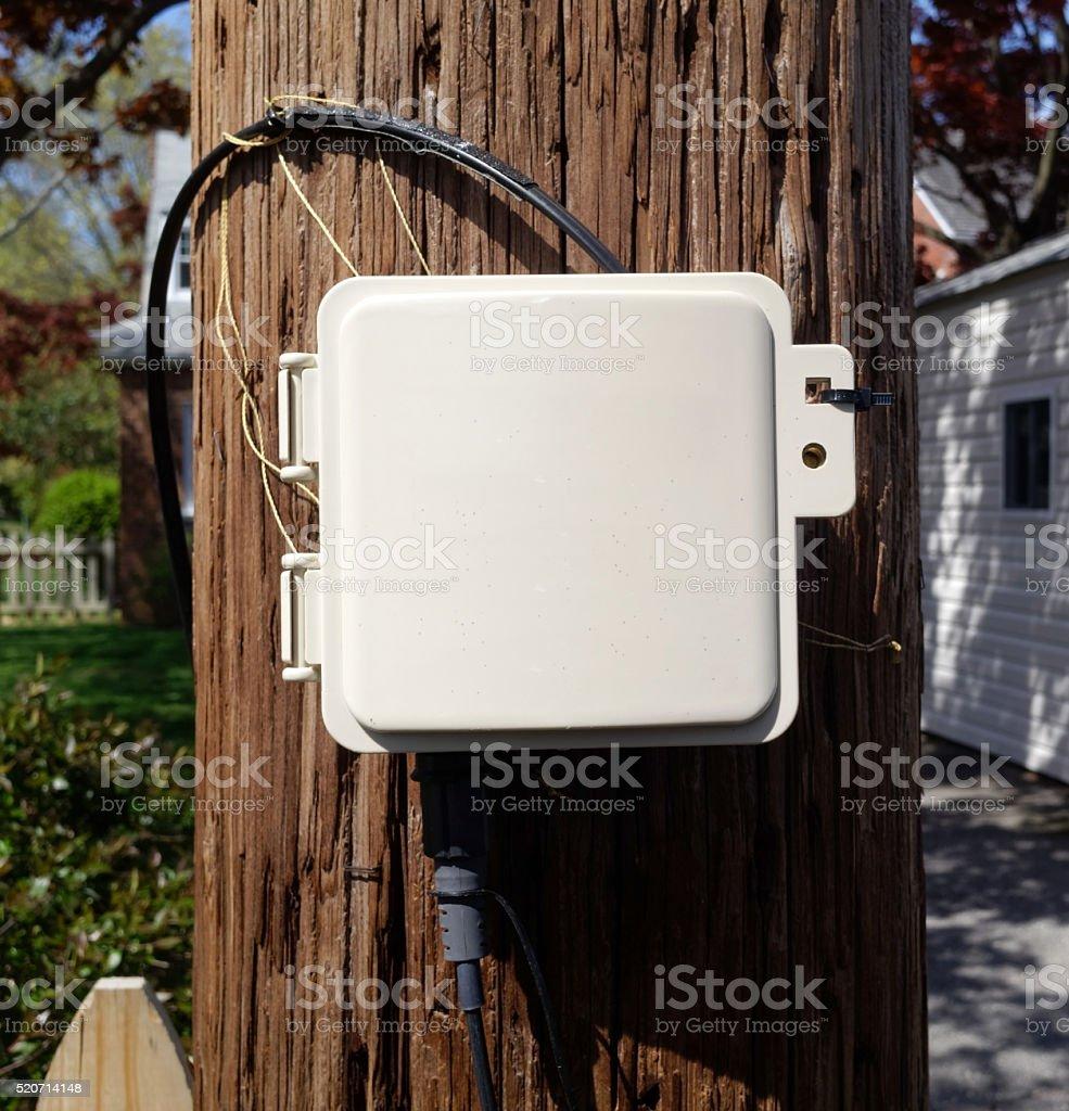Cable Communications Box Mounted On Telephone Pole Stock Photo