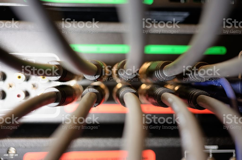 Cable connection panel on electronic equipment stock photo