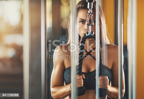 istock Cable extension workout. 641236388
