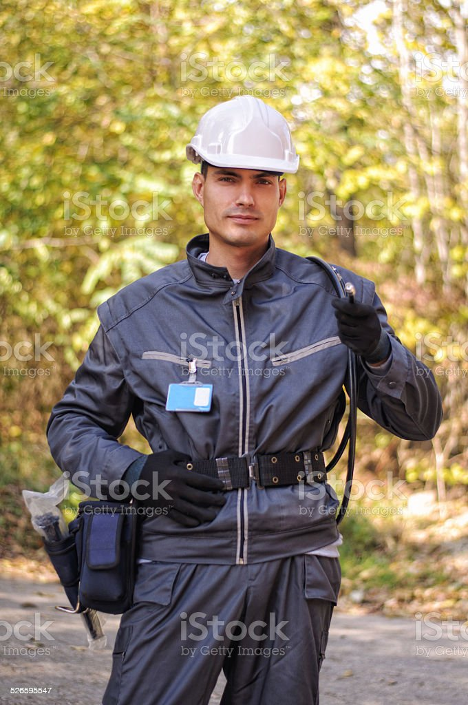 Cable guy holding optical cable stock photo