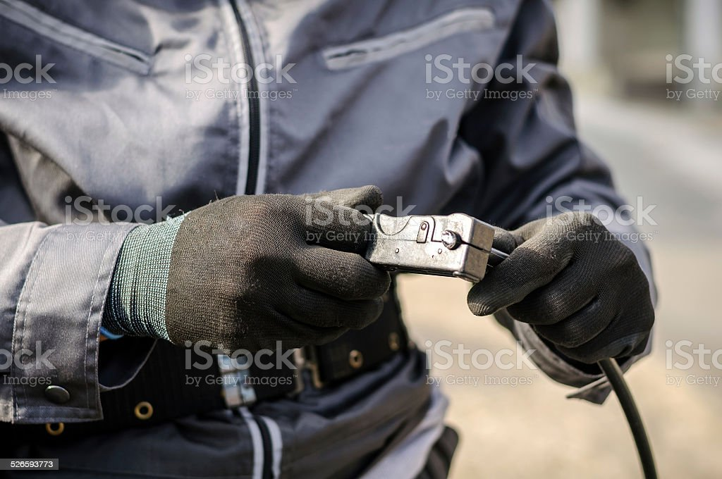 Cable guy prepairing optic/fiber cable stock photo
