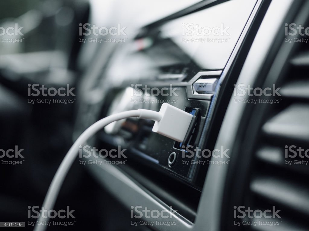 USB cable in the car stereo stock photo