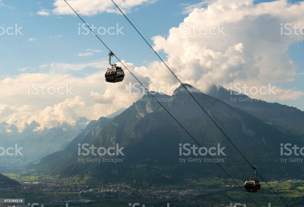 cable railway and panorama view of mountain landscape in Switzerland stock photo