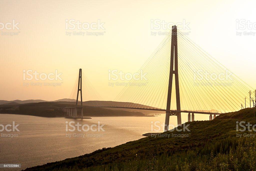 Cable stayed bridge 'Russky Bridge' on sunset. Vladivostok, Russia stock photo