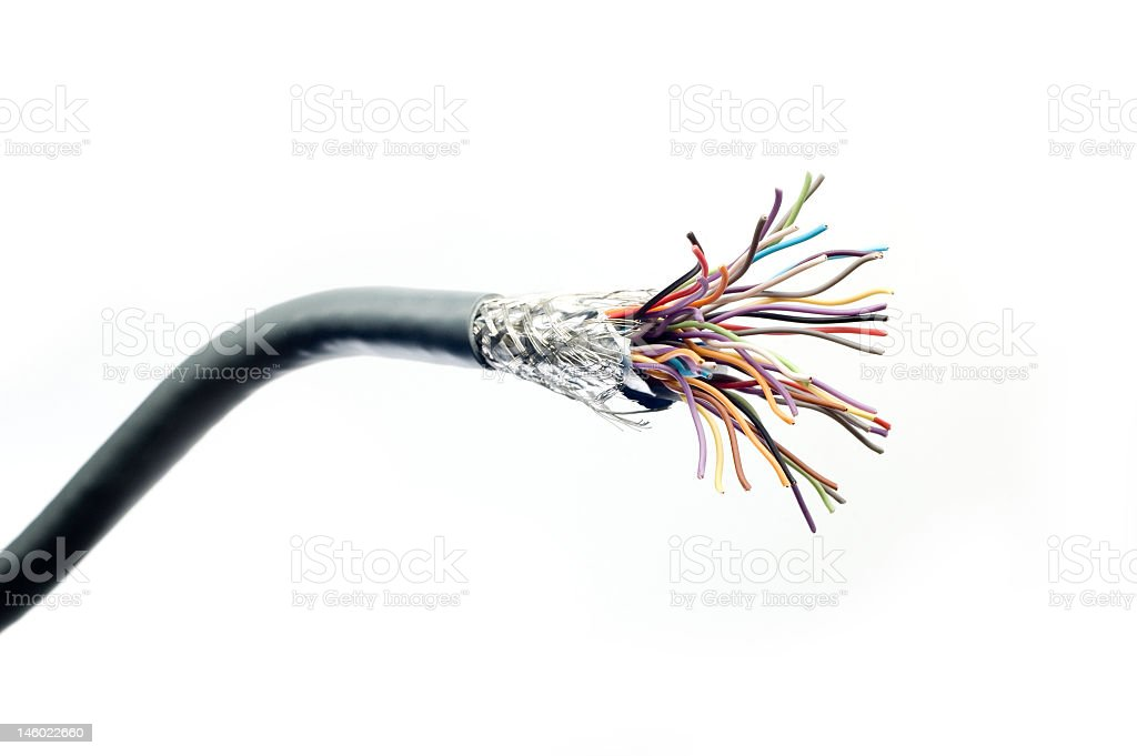 Cable that's been cut and frayed revealing the wires inside stock photo