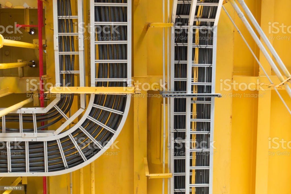 Cable tray with electrical wiring arrange on ceiling at offshore platform. stock photo