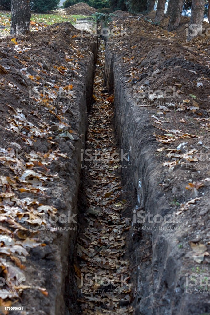 Cable trench in the ground, construction site stock photo