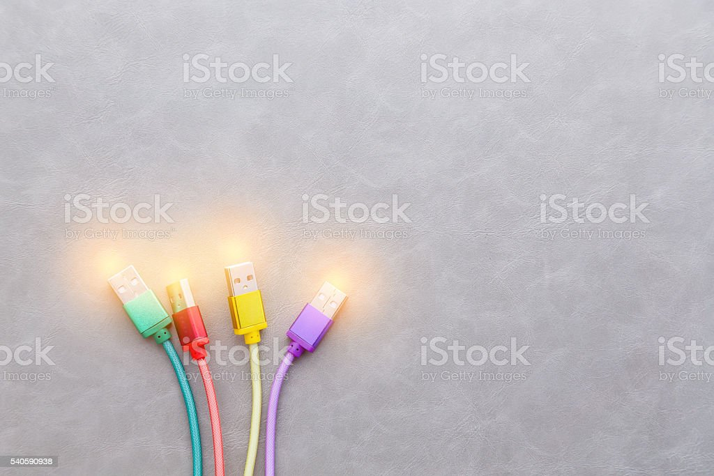 USB Cable with colorful cable on grey background stock photo