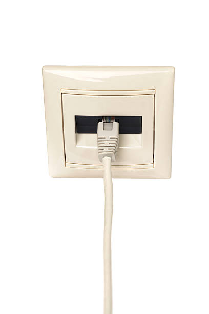 Cable with RJ-45 connector is connected to a wall outlet