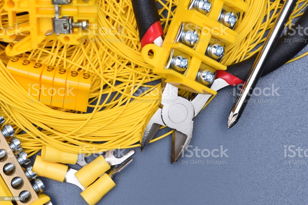 Cables, electrical equipment and tools on metal table royalty-free stock photo