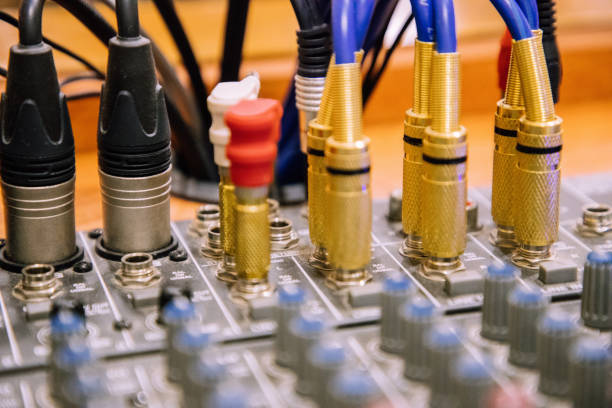 Cables entering mixer table perspective view blurred stock photo