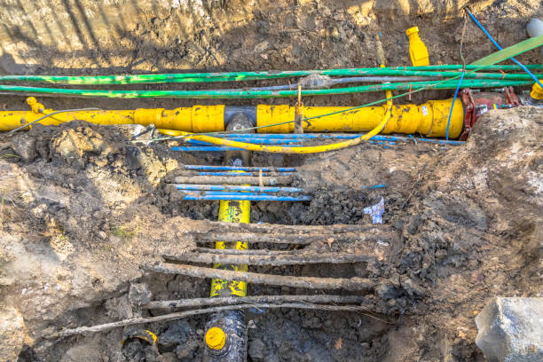 cables, pipes and sewage under pedestrian walkway stock photo