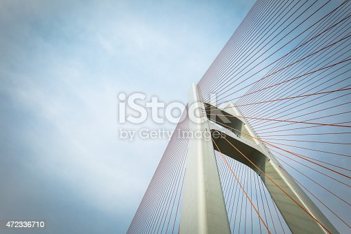 cable-stayed bridge closeup against a cloudy sky