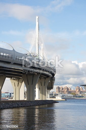 Cable-stayed bridge over a large river on a sunny day