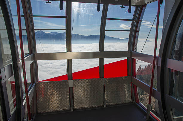 Cableway and sea of fog stock photo