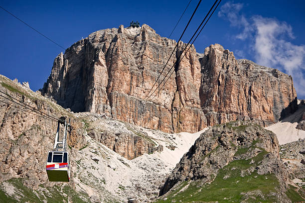 Cableway to Sass Pordoi, Dolomites in Summer The cableway to the peak of the Sass Pordoi mountain. The location is the Val di Fassa (Trentino-Alto Adige, Italy) during the summer season. high seat stock pictures, royalty-free photos & images