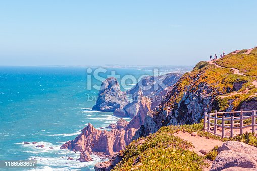 Cabo da roca, stunning views on blue turquoise ocean and purple rocks