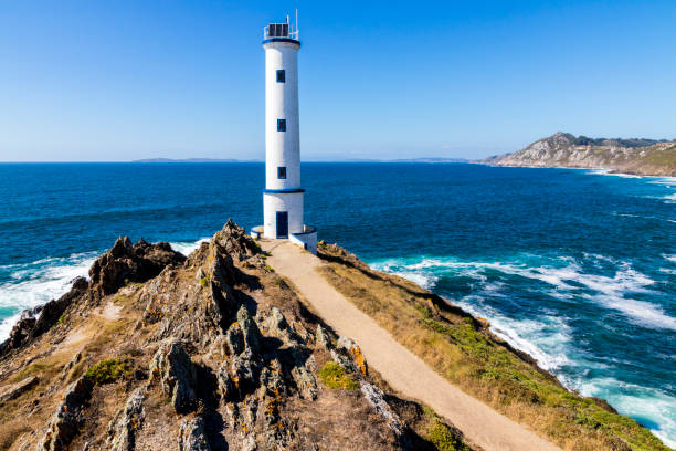 Cabo Home, Cangas, Galicia, Spain Lighthouse at Cabo Home, an iconic cape in Cangas, Pontevedra, Galicia, Spain beacon stock pictures, royalty-free photos & images