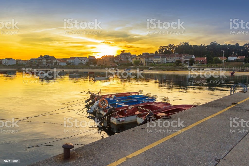 Cabodeiro beach and harbor at sunset royalty-free stock photo