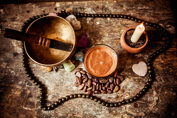 cacao beverage, tibetan singing bowl and gemstones - ceremonie stockfoto's en -beelden