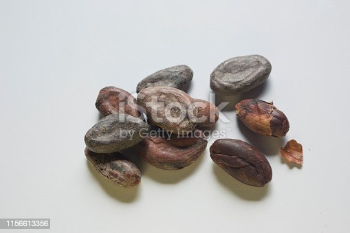 Extreme close-up of a group of cacao nibs (cocoa beans) with copy space. Chuao variety. Studio photography. Top view. Natural day light.