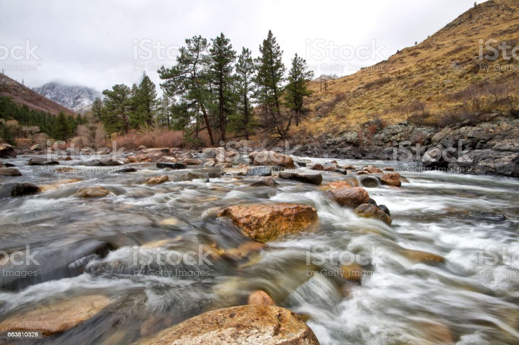 Cache Le Poudre River flows through the Poudre canyon in Northern Colorado stock photo