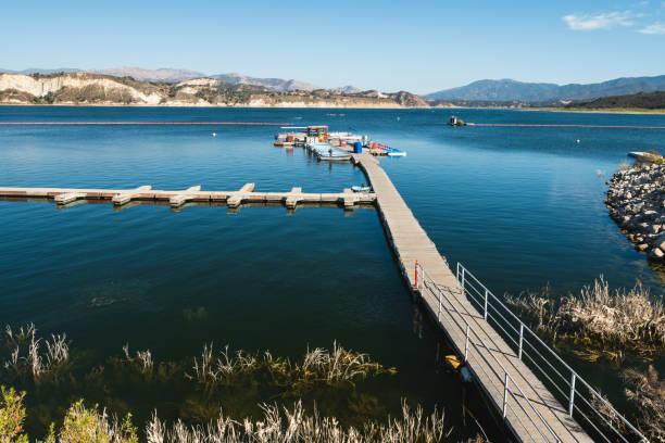 Cachuma Lake marina with a variety of fishing and pontoon boats, paddle boats, kayaks, and rowboats. stock photo