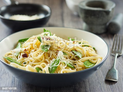 Home made freshness linguine with mangetout  and chopped hazelnut and parmesan cheese