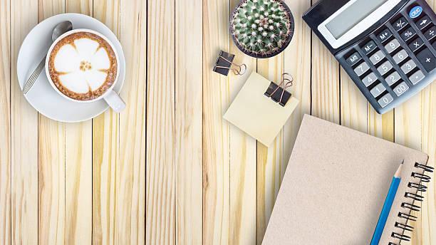 cactus, calculator, vintage book, clip, blue pencil and latte stock photo