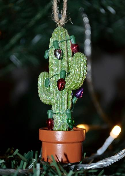 cactus shaped christmas decoration with tiny lights stock photo