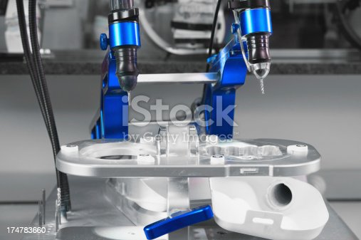 Cad Cam system for making dental crown and bridges from cyrconium oxide. Selective focus.You can find more dental related images like this one here :