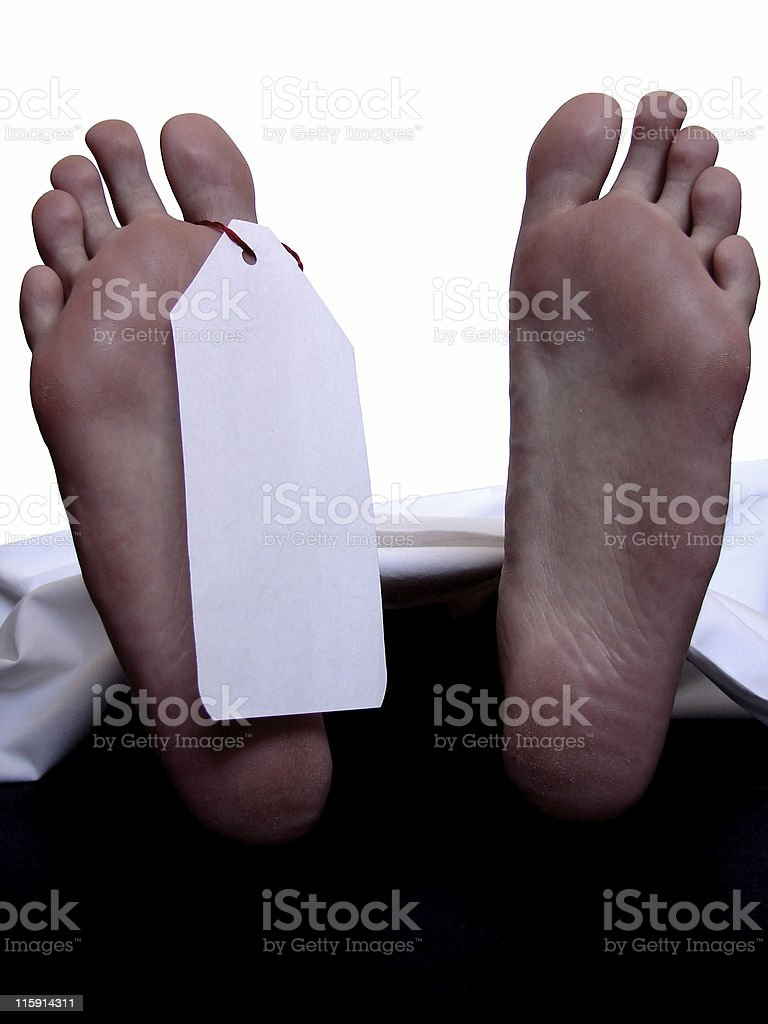Cadaver with blank toe tag royalty-free stock photo
