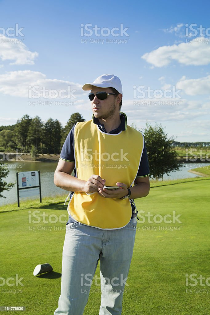 caddy at a golf course stock photo