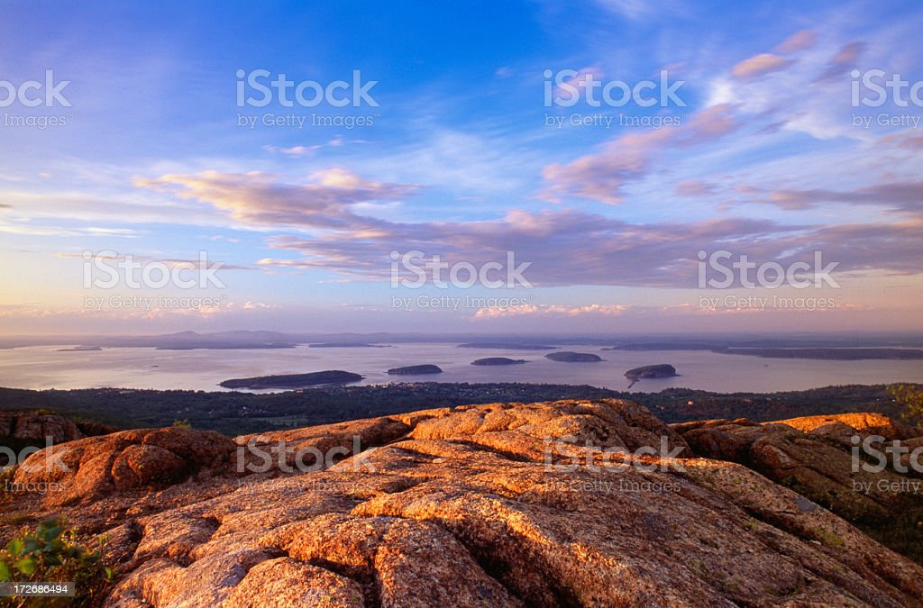 Cadillac Mountain with fog and wispy cloud stock photo